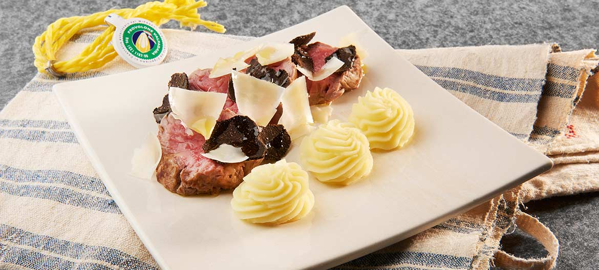 Beef fillet with strong Provolone Valpadana P.D.O. and black truffle