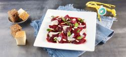 Red beet carpaccio with strong Provolone Valpadana P.D.O.