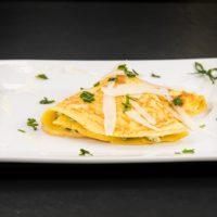 Crepes ricotta e spinaci con fonduta di Provolone Valpadana DOP dolce