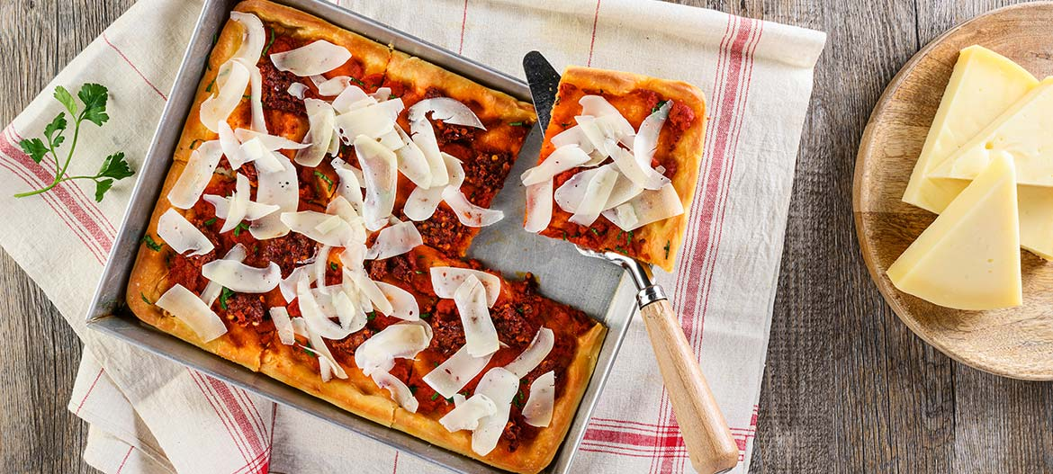 Red pizza with strong Provolone Valpadana and 'Nduja