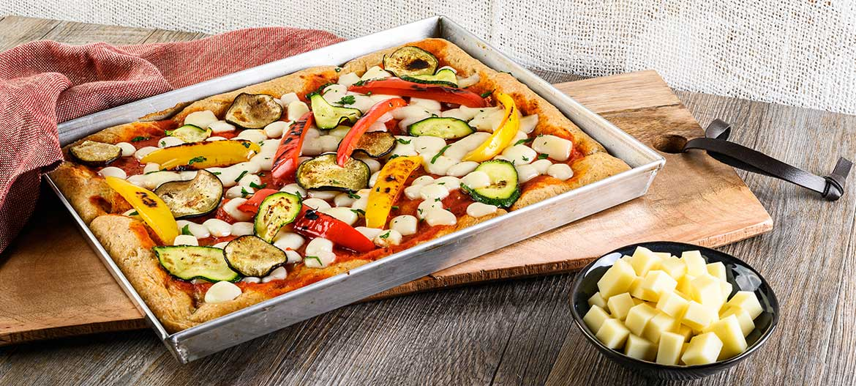 Red semi whole wheat pizza with mild Provolone Valpadana P.D.O.